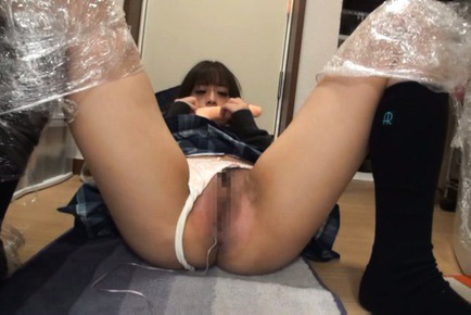 Japanese av model. Japanese AV Model with legs in plastic fucks herself with dildo